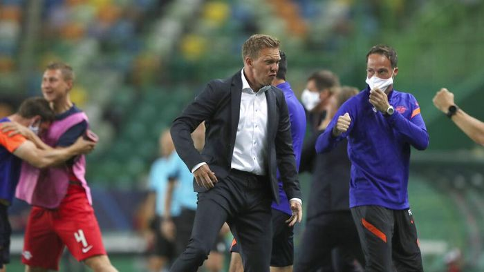 Leipzigs head coach Julian Nagelsmann celebrates his teams second goal during the Champions League quarterfinal match between RB Leipzig and Atletico Madrid at the Jose Alvalade stadium in Lisbon, Portugal, Thursday, Aug. 13, 2020. (Miguel A. Lopes/Pool Photo via AP)