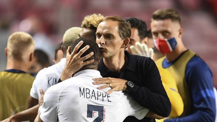 PSGs head coach Thomas Tuchel, right, embraces Kylian Mbappe after their win in the Champions League quarterfinal match between Atalanta and PSG at Luz stadium, Lisbon, Portugal, Wednesday, Aug. 12, 2020. (David Ramos/Pool Photo via AP)