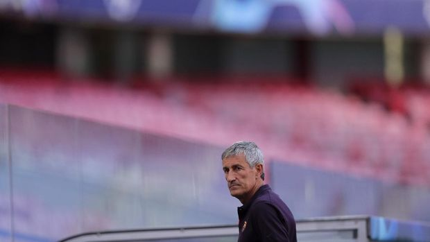 Barcelona's head coach Quique Setien gives an interview on the pitch before a training session at the Luz stadium in Lisbon, Thursday Aug. 13, 2020. Barcelona will play Bayern Munich in a Champions League quarterfinals soccer match on Friday. (AP Photo/Manu Fernandez, Pool)