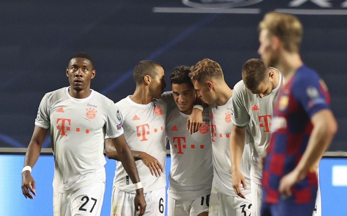 Bayern's Philippe Coutinho, center, celebrates after scoring his side's seventh goal during the Champions League quarterfinal soccer match between Barcelona and Bayern Munich in Lisbon, Portugal, Friday, Aug. 14, 2020. (Rafael Marchante/Pool via AP)
