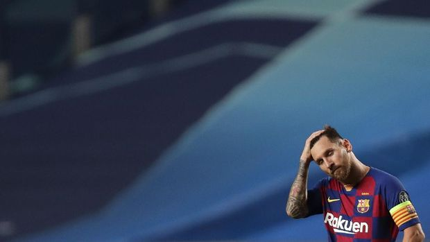 Barcelona's Lionel Messi holds his head during the Champions League quarterfinal match between FC Barcelona and Bayern Munich at the Luz stadium in Lisbon, Portugal, Friday, Aug. 14, 2020. (AP Photo/Manu Fernandez/Pool)