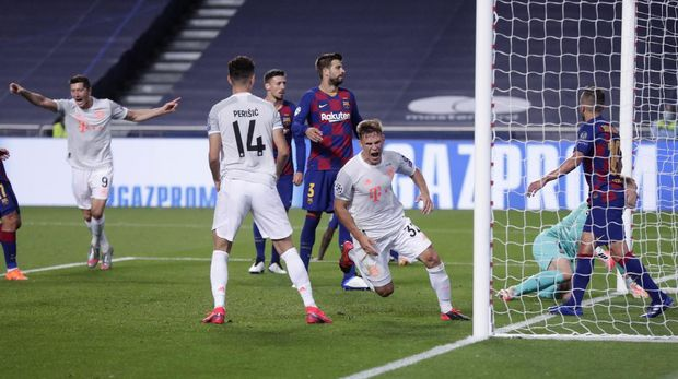 Bayern's Joshua Kimmich, center, celebrates after scoring his sides fifth goal during the Champions League quarterfinal match between FC Barcelona and Bayern Munich at the Luz stadium in Lisbon, Portugal, Friday, Aug. 14, 2020. (AP Photo/Manu Fernandez/Pool)