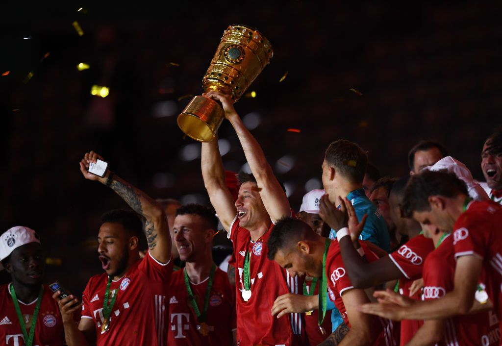 BERLIN, GERMANY - JULY 04: Bayern Munich's Robert Lewandowski celebrates with the trophy after winning the DFB Cup final match between Bayer 04 Leverkusen and FC Bayern Muenchen at Olympiastadion on July 4, 2020 in Berlin, Germany. (Photo by Annegret Hilse/Pool via Getty Images)