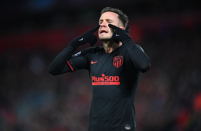 LIVERPOOL, ENGLAND - MARCH 11: Saul Niguez of Atletico Madrid reacts during the UEFA Champions League round of 16 second leg match between Liverpool FC and Atletico Madrid at Anfield on March 11, 2020 in Liverpool, United Kingdom.  (Photo by Laurence Griffiths/Getty Images)