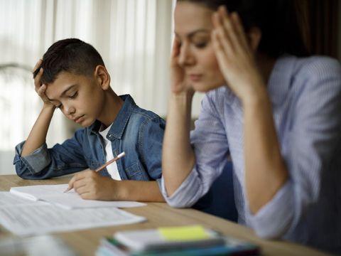 Teenage boy having problems in finishing homework