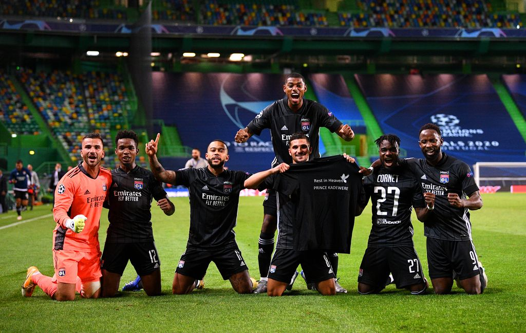 LISBON, PORTUGAL - AUGUST 15: Olympique Lyon players show respects for teammate Tino Kadewere, following the death of his brother, Prince Kadewere, as they celebrate following their team's victory in the UEFA Champions League Quarter Final match between Manchester City and Lyon at Estadio Jose Alvalade on August 15, 2020 in Lisbon, Portugal. (Photo by Franck Fife/Pool via Getty Images)
