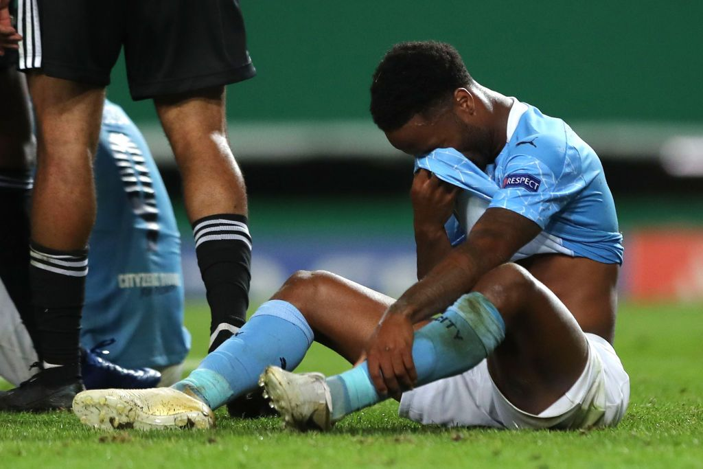 LISBON, PORTUGAL - AUGUST 15: Raheem Sterling of Manchester City looks dejected following his team's defeat in the UEFA Champions League Quarter Final match between Manchester City and Lyon at Estadio Jose Alvalade on August 15, 2020 in Lisbon, Portugal. (Photo by Miguel A. Lopes/Pool via Getty Images)