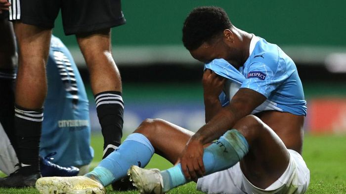 LISBON, PORTUGAL - AUGUST 15: Raheem Sterling of Manchester City looks dejected following his teams defeat in the UEFA Champions League Quarter Final match between Manchester City and Lyon at Estadio Jose Alvalade on August 15, 2020 in Lisbon, Portugal. (Photo by Miguel A. Lopes/Pool via Getty Images)