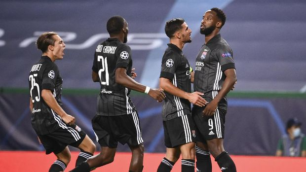Lyon's Moussa Dembele, right, celebrates with his teammates after scoring his team's third goal during the Champions League quarterfinal match between Manchester City and Lyon at the Jose Alvalade stadium in Lisbon, Portugal, Saturday, Aug. 15, 2020. (Franck Fife/Pool Photo via AP)