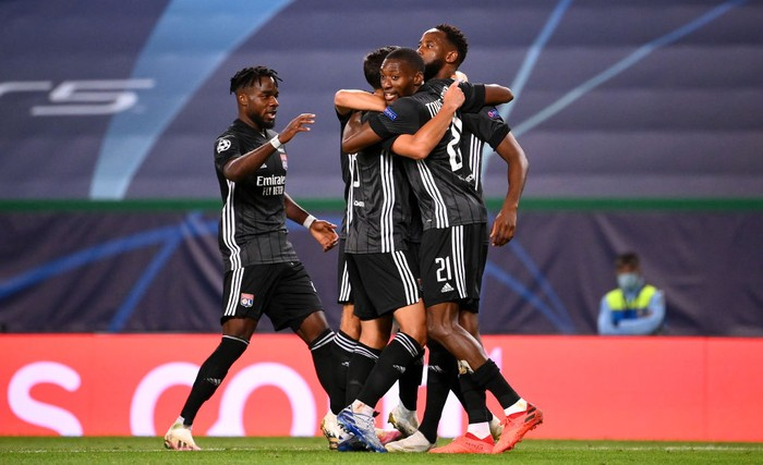 LISBON, PORTUGAL - AUGUST 15: Moussa Dembele of Olympique Lyon celebrates with teammates after scoring his teams third goal during the UEFA Champions League Quarter Final match between Manchester City and Lyon at Estadio Jose Alvalade on August 15, 2020 in Lisbon, Portugal. (Photo by Franck Fife/Pool via Getty Images)