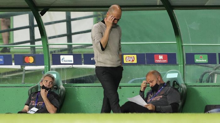 Manchester Citys head coach Pep Guardiola reacts during the Champions League quarterfinal soccer match between Lyon and Manchester City at the Jose Alvalade stadium in Lisbon, Portugal, Saturday, Aug. 15, 2020. (Miguel A. Lopes/Pool via AP)