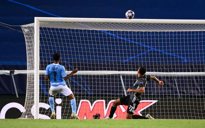 LISBON, PORTUGAL - AUGUST 15: Raheem Sterling of Manchester City misses a chance during the UEFA Champions League Quarter Final match between Manchester City and Lyon at Estadio Jose Alvalade on August 15, 2020 in Lisbon, Portugal. (Photo by Franck Fife/Pool via Getty Images)