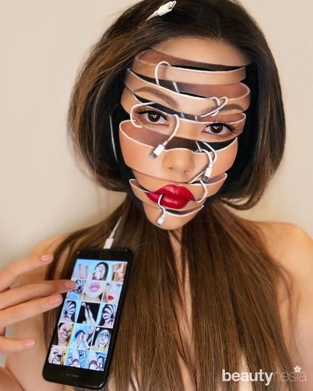 Potret makeup ilusi Mimi Choi yang menunjukkan irisan pada wajahnya karena terlilit earphone.