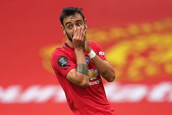 MANCHESTER, ENGLAND - JULY 04: Bruno Fernandes of Manchester United reacts after a missed chance during the Premier League match between Manchester United and AFC Bournemouth  at Old Trafford on July 04, 2020 in Manchester, England. Football Stadiums around Europe remain empty due to the Coronavirus Pandemic as Government social distancing laws prohibit fans inside venues resulting in all fixtures being played behind closed doors. (Photo by Dave Thompson/Pool via Getty Images)