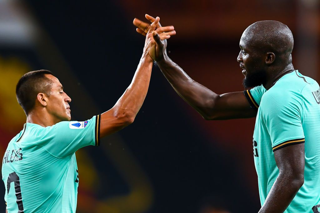 GENOA, ITALY - JULY 25: Romelu Lukaku of Inter (right) celebrates with his team-mate Alexis Sanchez after scoring his second goal during the Serie A match between Genoa CFC and  FC Internazionale at Stadio Luigi Ferraris on July 25, 2020 in Genoa, Italy. (Photo by Paolo Rattini/Getty Images)