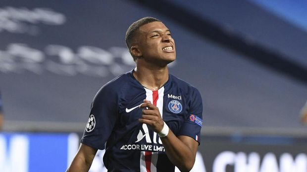 PSG's Kylian Mbappe reacts after missing an opportunity to score during the Champions League semifinal soccer match between RB Leipzig and Paris Saint-Germain at the Luz stadium in Lisbon, Portugal, Tuesday, Aug. 18, 2020. (David Ramos/Pool Photo via AP)