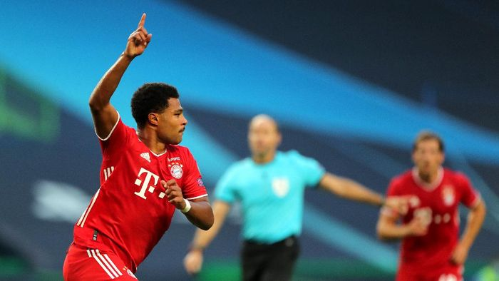 LISBON, PORTUGAL - AUGUST 19: Serge Gnabry of Bayern Munich celebrates after scoring his teams first goal during the UEFA Champions League Semi Final match between Olympique Lyonnais and Bayern Munich at Estadio Jose Alvalade on August 19, 2020 in Lisbon, Portugal. (Photo by Miguel A. Lopes/Pool via Getty Images)