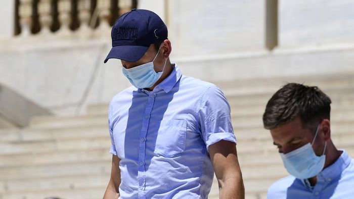 England soccer player Harry Maguire leaves a court building on the Aegean island of Syros, Greece, on Saturday, August 22, 2020. The Manchester United captain was arrested during a brawl on the neighbouring holiday island of Mykonos. (AP Photo/Michalis Varaklas)