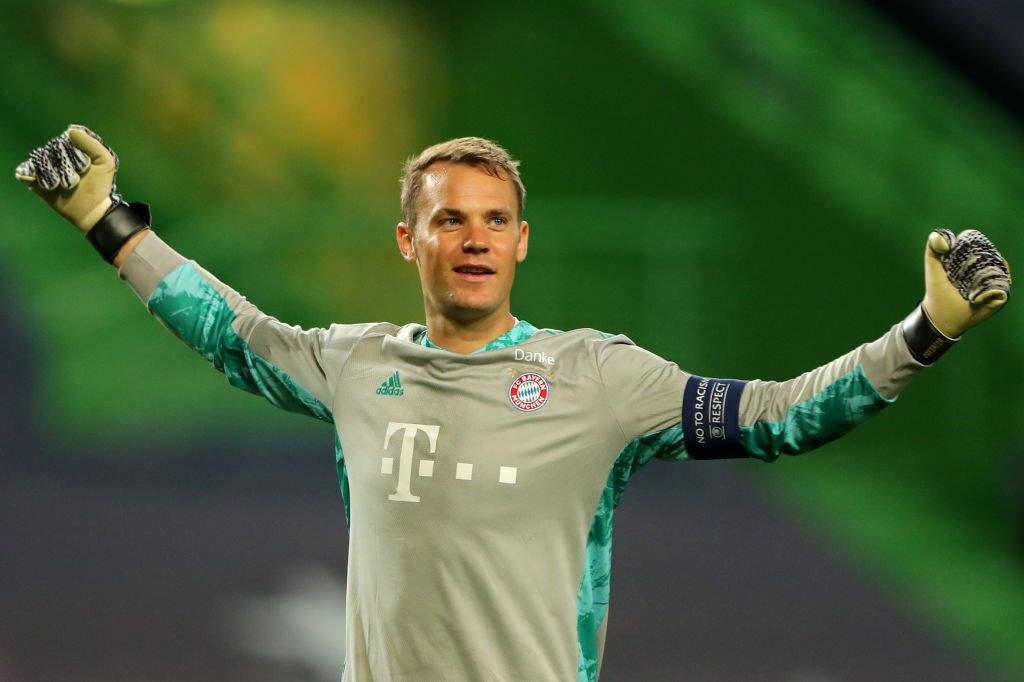 LISBON, PORTUGAL - AUGUST 19: Manuel Neuer of Bayern Munich celebrates after his teammate Robert Lewandowski of Bayern Munich (not pictured) scored their team's third goal during the UEFA Champions League Semi Final match between Olympique Lyonnais and Bayern Munich at Estadio Jose Alvalade on August 19, 2020 in Lisbon, Portugal. (Photo by Miguel A. Lopes/Pool via Getty Images)