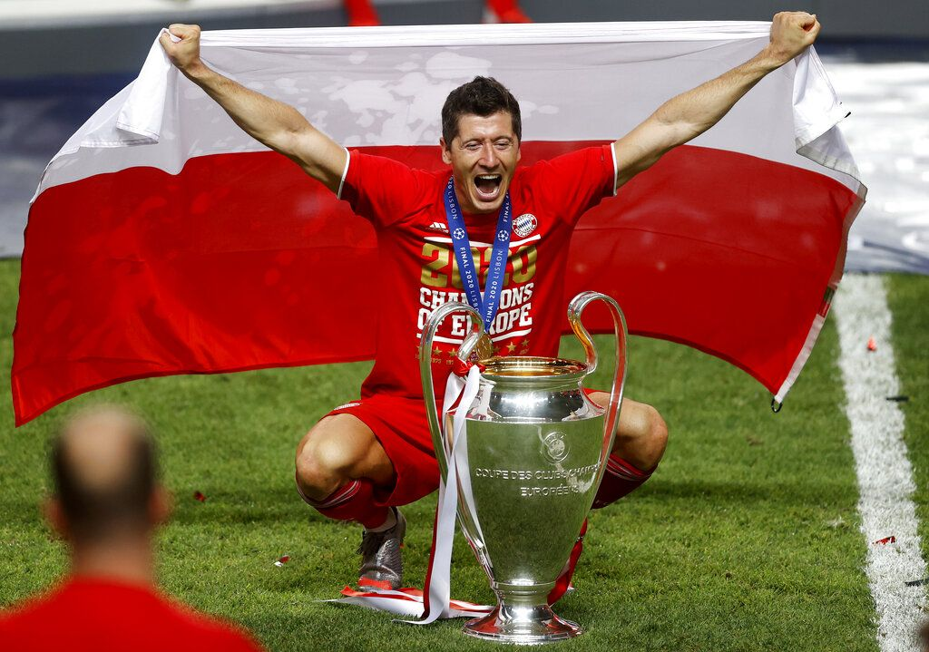 Bayern's Robert Lewandowski celebrates with the trophy after Munich won the Champions League final soccer match between Paris Saint-Germain and Bayern Munich at the Luz stadium in Lisbon, Portugal, Sunday, Aug. 23, 2020.(Matthew Childs/Pool via AP)