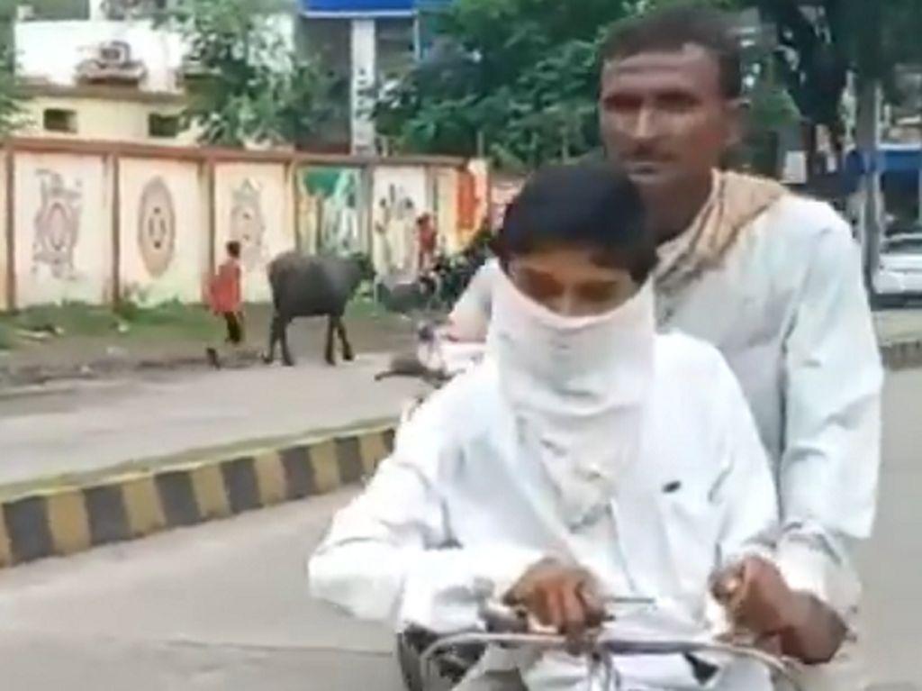 Haru, Ayah Rela Tempuh 105 Km dengan Sepeda Demi Antar Anaknya ke Sekolah