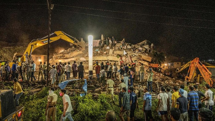 Rescue workers look for survivors after a residential building collapsed in Mahad, about 170 kilometers (105 miles) from Indias financial capital of Mumbai, Monday, Aug. 24, 2020. Many people feared injured and more than 65 were trapped inside after a residential building caved in on Monday evening in the central Indian state of Maharashtra. (AP Photo)