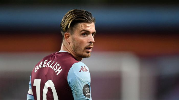 BIRMINGHAM, ENGLAND - JULY 21: Jack Grealish of Aston Villa looks on during the Premier League match between Aston Villa and Arsenal FC at Villa Park on July 21, 2020 in Birmingham, England. Football Stadiums around Europe remain empty due to the Coronavirus Pandemic as Government social distancing laws prohibit fans inside venues resulting in all fixtures being played behind closed doors. (Photo by Peter Powell/Pool via Getty Images)