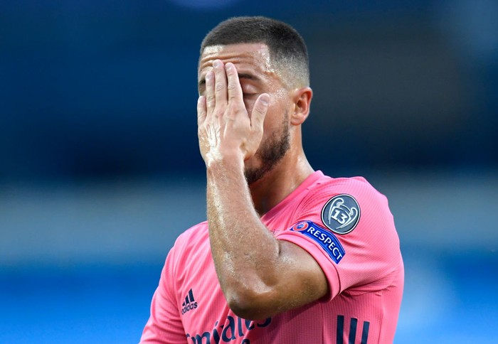 MANCHESTER, ENGLAND - AUGUST 07: Eden Hazard of Real Madrid reacts during the UEFA Champions League round of 16 second leg match between Manchester City and Real Madrid at Etihad Stadium on August 07, 2020 in Manchester, England. (Photo by Peter Powell/Pool via Getty Images)