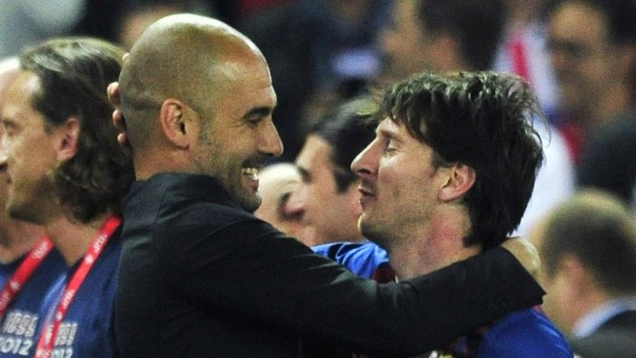 (FILES) In this file photo taken on May 25, 2012 Barcelonas coach Josep Guardiola (L) embraces Barcelonas Argentinian forward Lionel Messi (R) at the end of the Spanish Kings Cup final football match between Athletic Bilbao and FC Barcelona at the Vicente Calderon stadium in Madrid. - Six-time Ballon dOr winner Lionel Messi told Barcelona he wants to leave -- on a free transfer -- in a