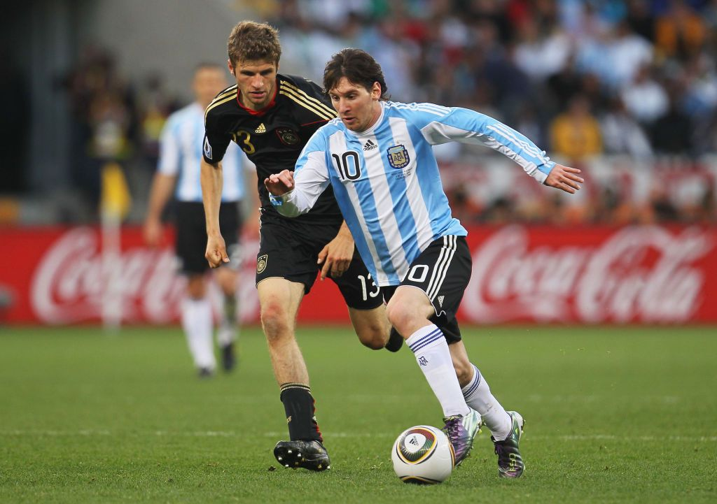 CAPE TOWN, SOUTH AFRICA - JULY 03:  Lionel Messi of Argentina is pursued by Thomas Mueller of Germany during the 2010 FIFA World Cup South Africa Quarter Final match between Argentina and Germany at Green Point Stadium on July 3, 2010 in Cape Town, South Africa.  (Photo by Chris McGrath/Getty Images)