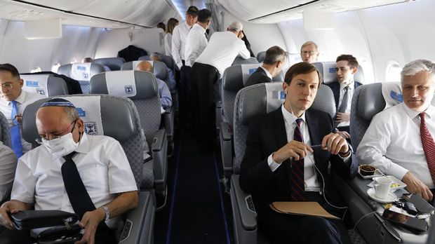 Israeli National Security Advisor Meir Ben-Shabbat, left, U.S. National Security Advisor Robert O'Brien, right, and U.S. President Donald Trump's senior adviser Jared Kushner are seated during a flight on an Israeli El Al airliner to Abu Dhabi, United Arab Emirates, Monday, Aug. 31, 2020. The plane landed in Abu Dhabi after flying in from Israel in the first-ever direct commercial passenger flight to the United Arab Emirates. (Nir Elias/Pool Photo via AP)