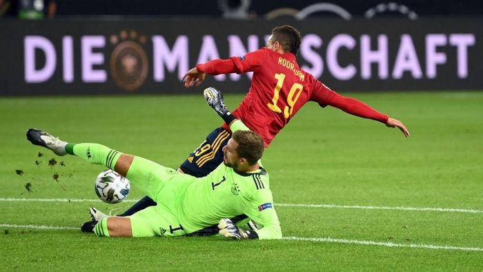 STUTTGART, GERMANY - SEPTEMBER 03: Kevin Trapp of Germany saves a shot from Rodrigo Moreno of Spain during the UEFA Nations League group stage match between Germany and Spain at Mercedes-Benz Arena on September 03, 2020 in Stuttgart, Germany. (Photo by Matthias Hangst/Getty Images)
