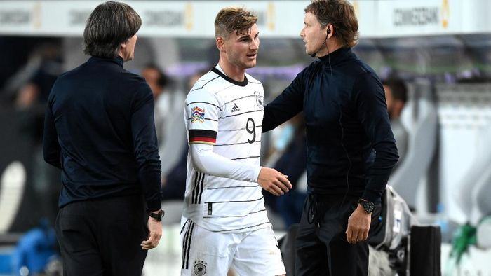 STUTTGART, GERMANY - SEPTEMBER 03: Timo Werner of Germany and Joachim Loew, Head Coach of Germany interact as Timo Werner is substituted off during the UEFA Nations League group stage match between Germany and Spain at Mercedes-Benz Arena on September 03, 2020 in Stuttgart, Germany. (Photo by Matthias Hangst/Getty Images)