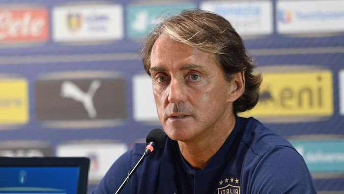 """Italy soccer team coach Roberto Mancini speaks to the media at the Coverciano training grounds, in Florence, Italy, Sunday, Aug. 30, 2020. Italy hosts Bosnia-Herzegovina inside an empty stadium on Friday, Sept. 4, 2020, in the Nations League. """"I'll definitely feel a bit sad,"""" Mancini said about the prospect of playing in an empty stadium, due to the coronavirus pandemic. (Jennifer Lorenzini/LaPresse via AP)"""
