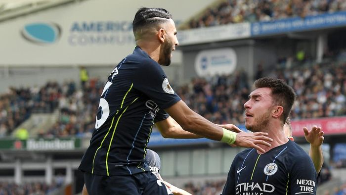 BRIGHTON, ENGLAND - MAY 12: Aymeric Laporte of Manchester City celebrates with teammate Riyad Mahrez after scoring his teams second goal during the Premier League match between Brighton & Hove Albion and Manchester City at American Express Community Stadium on May 12, 2019 in Brighton, United Kingdom. (Photo by Mike Hewitt/Getty Images)