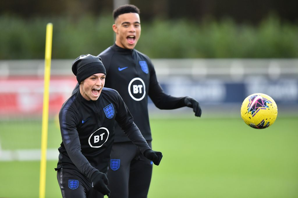 BURTON-UPON-TRENT, ENGLAND - NOVEMBER 11: Phil Foden and Mason Greenwood of England U21s takes part in a training session at St Georges Park on November 11, 2019 in Burton-upon-Trent, England. (Photo by Nathan Stirk/2019 Getty Images)