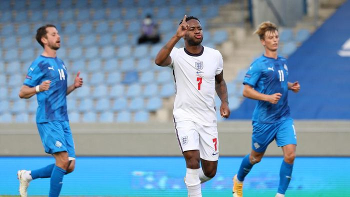 REYKJAVIK, ICELAND - SEPTEMBER 05: Raheem Sterling of England celebrates scoring his sides first goal from the penalty spot during the UEFA Nations League group stage match between Iceland and England at Laugardalsvollur National Stadium on September 05, 2020 in Reykjavik, Iceland. (Photo by Haflidi Breidfjord/Getty Images)