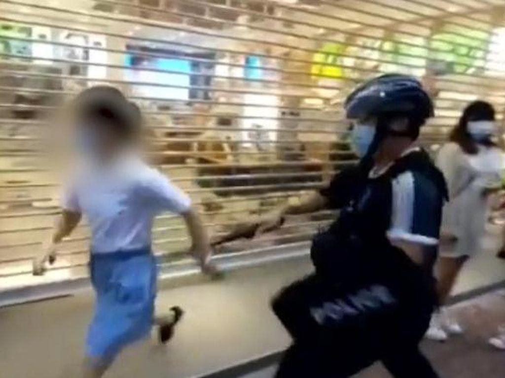 Amankan Bocah 12 Tahun Hingga Jatuh, Polisi Hong Kong Dikritik