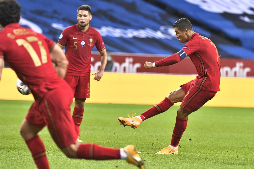 Portugal's Christiano Ronaldo shoots a free-kick to score against Sweden during their UEFA Nations League Group stage soccer match at Friends Arena in Stockholm, Sweden, Tuesday Sept. 8, 2020. (Claudio Bresciani / TT via AP)