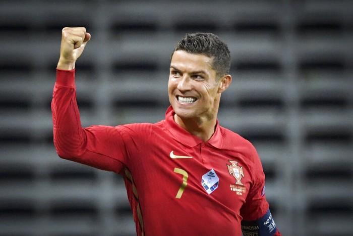 Portugals Ronaldo celebrates after scoring against Sweden during their UEFA Nations League Group stage soccer match at Friends Arena in Stockholm, Sweden, Tuesday Sept. 8, 2020. (Janerik Henriksson / TT via AP)
