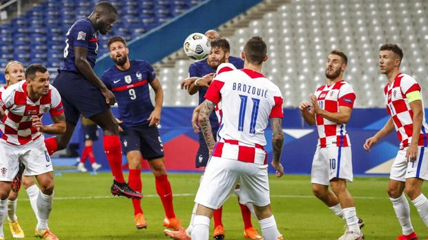 France's Dayot Upamecano scores during a UEFA Nations League soccer match against Croatia at the Stade de France stadium in Saint-Denis, north of Paris, France, Tuesday, Sept. 8, 2020. (AP Photo/Francois Mori)