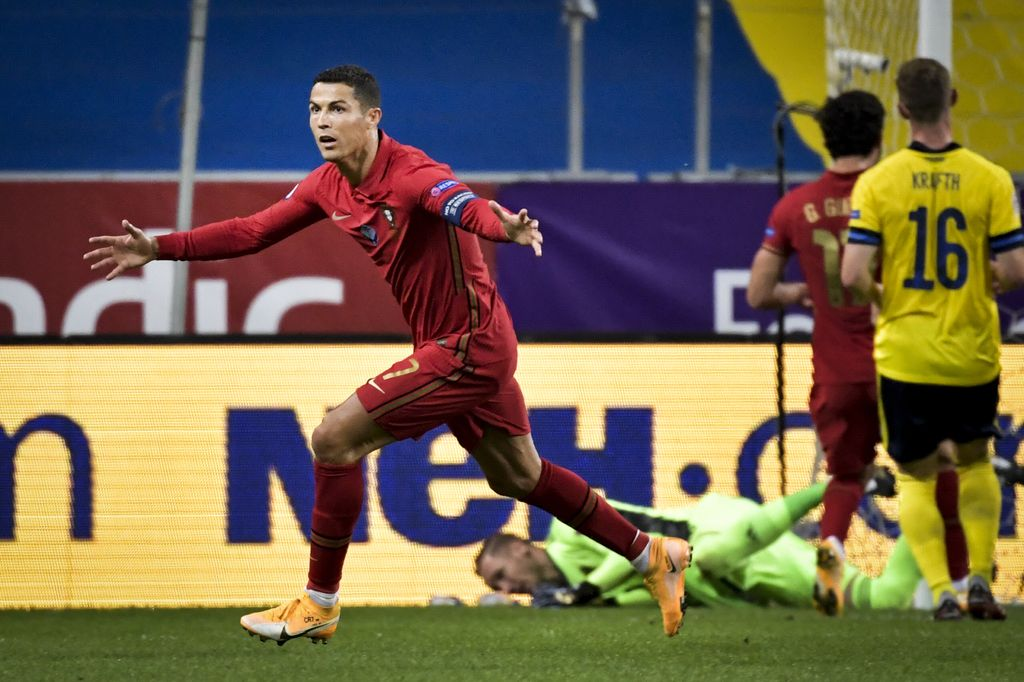Portugals Cristiano Ronaldo celebrates after scoring against Sweden during the game against Portugal during their UEFA Nations League Group stage soccer match at Friends Arena in Stockholm, Sweden, Tuesday Sept. 8, 2020. (Janerik Henriksson / TT via AP)
