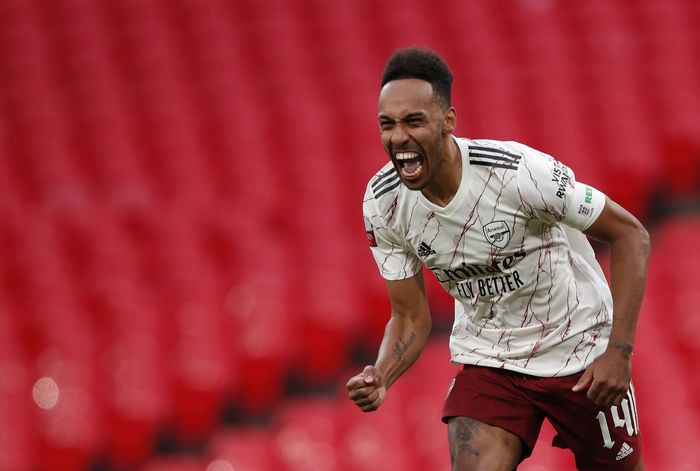 Arsenals Pierre-Emerick Aubameyang celebrates after scores the winning penalty in a penalty shootout at the end of the English FA Community Shield soccer match between Arsenal and Liverpool at Wembley stadium in London, Saturday, Aug. 29, 2020. (Andrew Couldridge/Pool via AP)