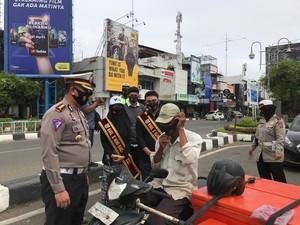 Tingkatkan Kesadaran Warga Pakai Masker, Polisi Aceh Gandeng Duta Wisata