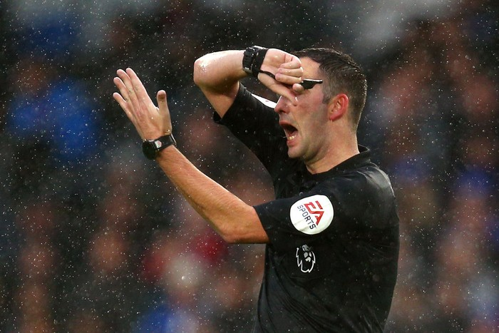 BRIGHTON, ENGLAND - SEPTEMBER 22:  Referee Christopher Kavanagh signals a handball conceded by Glenn Murray of Brighton and Hove Albion  during the Premier League match between Brighton & Hove Albion and Tottenham Hotspur at American Express Community Stadium on September 22, 2018 in Brighton, United Kingdom.  (Photo by Charlie Crowhurst/Getty Images)