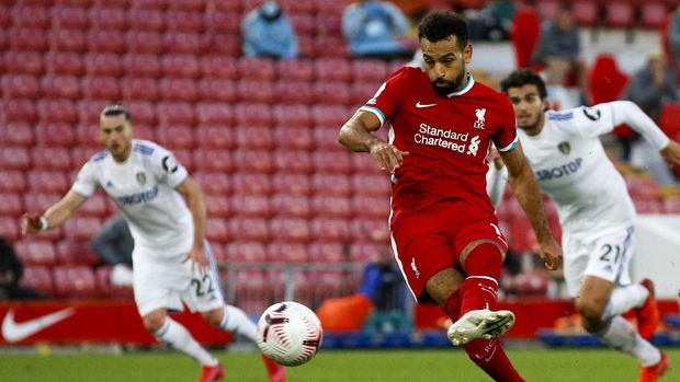 Liverpool's Mohamed Salah scores his side's fourth goal on a penalty kick during the English Premier League soccer match between Liverpool and Leeds United, at the Anfield stadium, in Liverpool, Saturday, Sept. 12, 2020. (Phil Noble, Pool via AP)