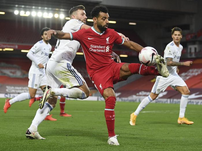 Liverpools Mohamed Salah, right, and Leeds Uniteds Stuart Dallas fight for the ball during the English Premier League soccer match between Liverpool and Leeds United, at the Anfield stadium, in Liverpool, Saturday, Sept. 12, 2020. (Shaun Botterill, Pool via AP)