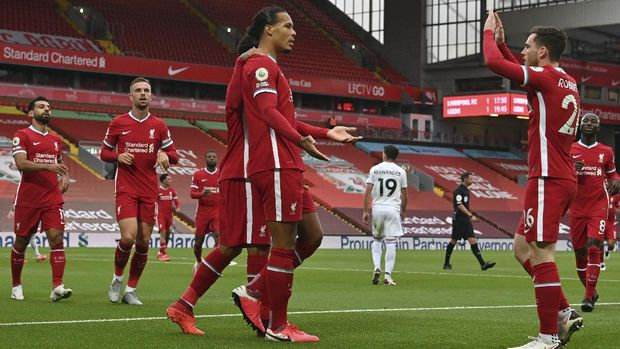 Liverpool's Virgil van Dijk, center, celebrates with his teammates after he scored his side's second goal during the English Premier League soccer match between Liverpool and Leeds United, at the Anfield stadium, in Liverpool, Saturday, Sept. 12, 2020. (Paul Ellis, Pool via AP)