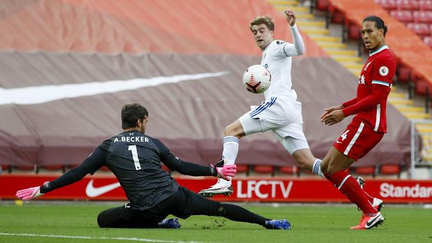 Leeds United's Patrick Bamford, center scores his side's second goal during the English Premier League soccer match between Liverpool and Leeds United, at the Anfield stadium, in Liverpool, Saturday, Sept. 12, 2020. (Phil Noble, Pool via AP)