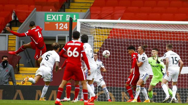 Liverpool's Virgil van Dijk, left, scores his side's second goal during the English Premier League soccer match between Liverpool and Leeds United, at the Anfield stadium, in Liverpool, Saturday, Sept. 12, 2020. (Phil Noble, Pool via AP)